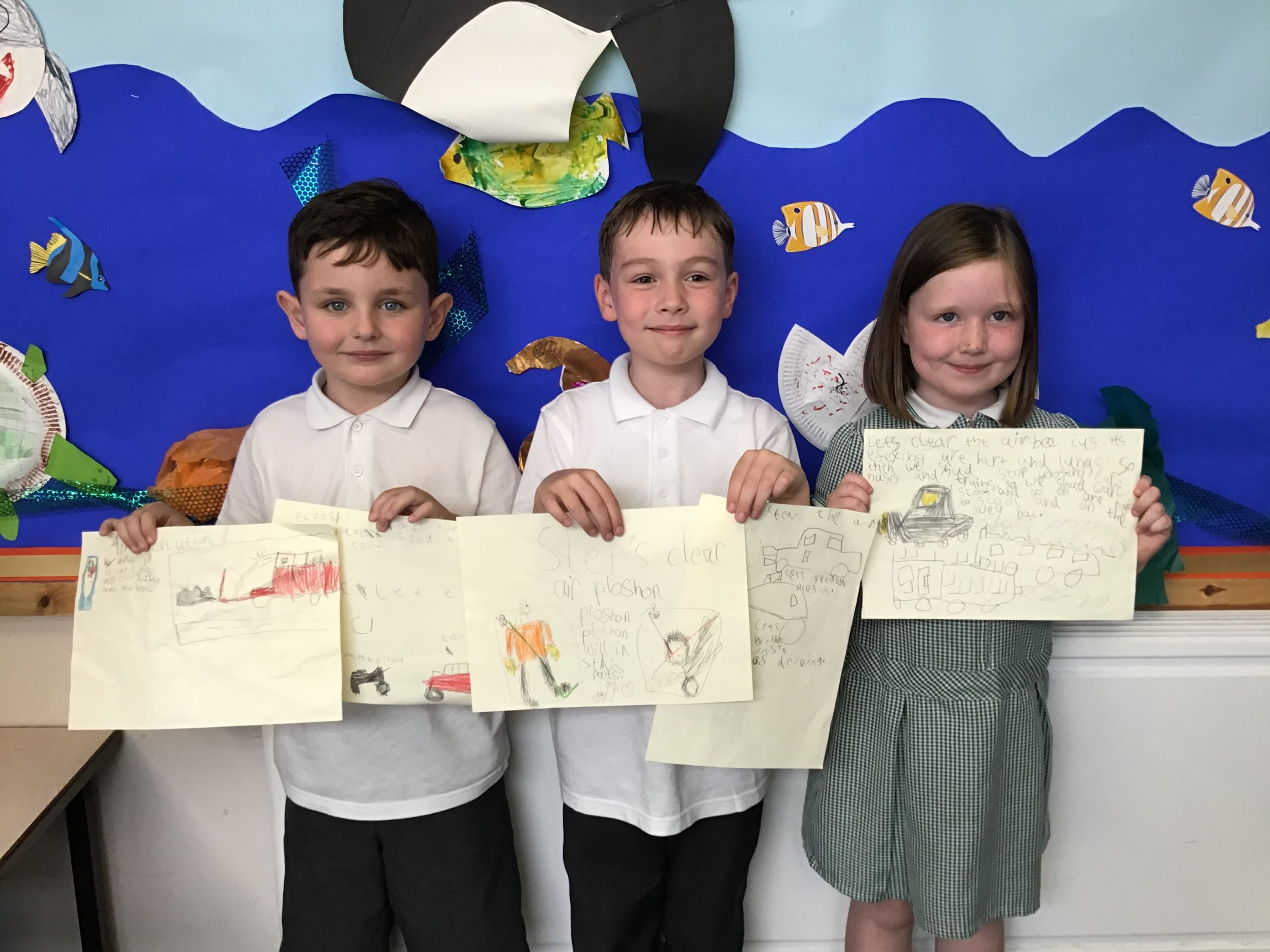 Pupils from St Pauls adn St Timothys School holding clean air posters